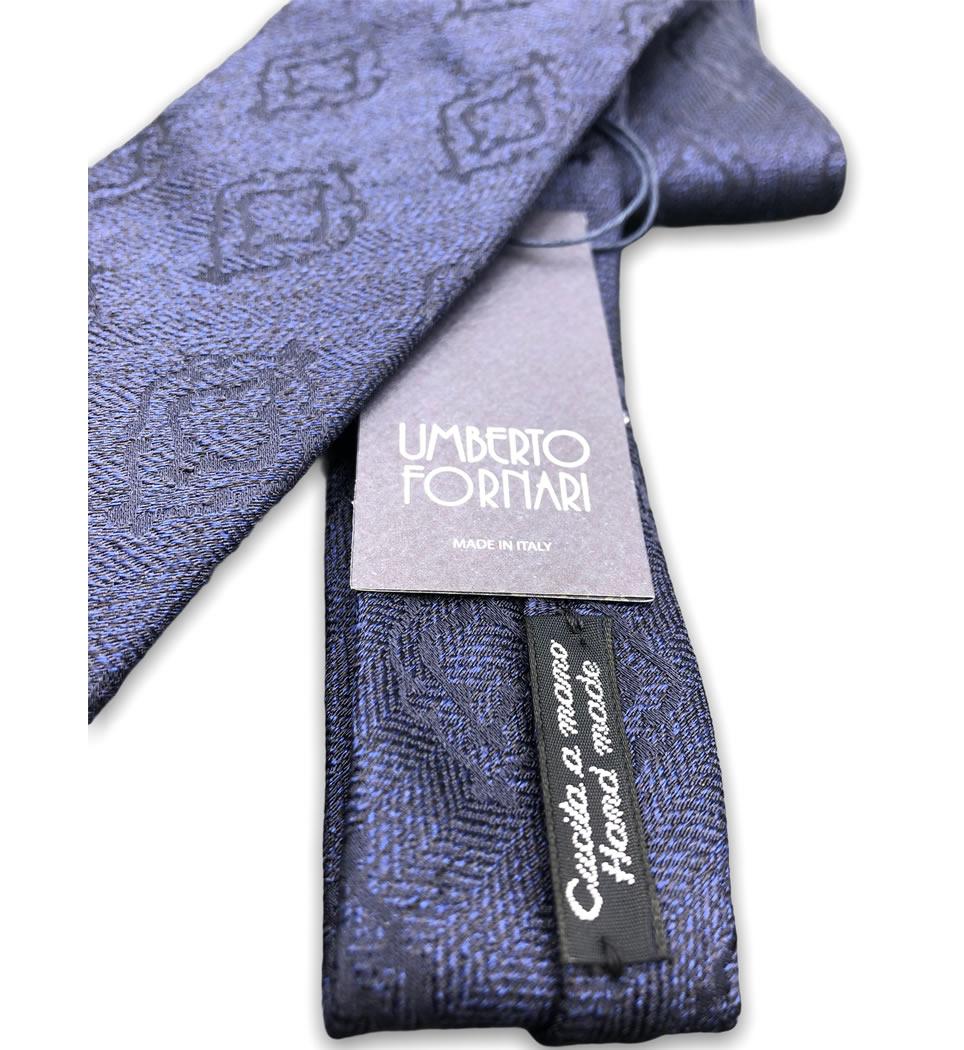 Cravatta cucita a mano 7 cm fantasia fondo bluette 100% seta