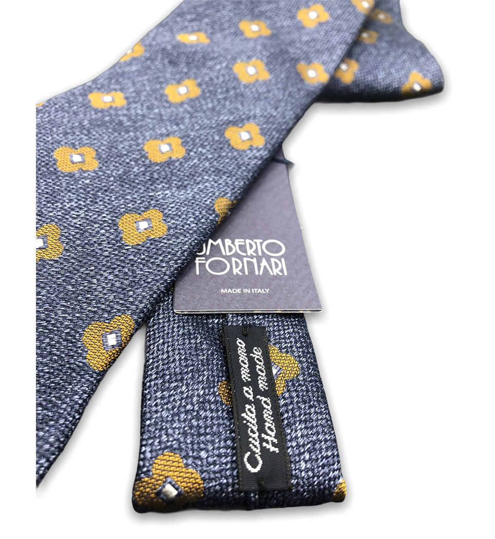 Cravatta cucita a mano 7,5 cm fantasia fondo bluette 100% seta
